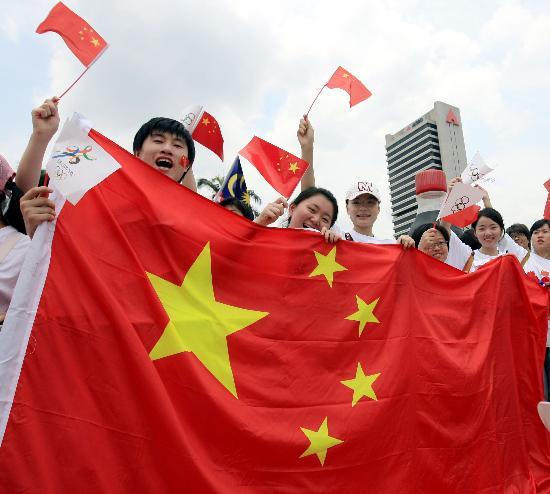 图文-奥运圣火在吉隆坡传递 齐心协力为圣火助威