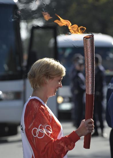 图文-北京奥运圣火在堪培拉传递 特里克特传递圣火