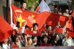 图文-北京奥运会火炬在长野传递 依旧赤诚中国心