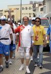 图文-奥运圣火在澳门传递高龄火炬手精神矍铄传递