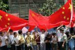 图文-北京奥运圣火在三亚传递 五星红旗随处可见