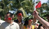 图文-北京奥运圣火在三亚传递 三亚市民的豪迈