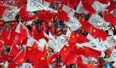图文-北京奥运圣火贵州凯里传递 传递现场中国红