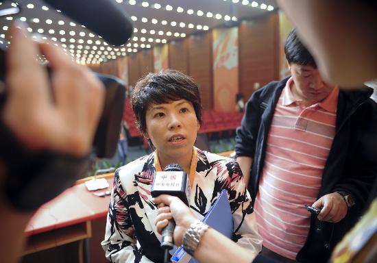图文-北京奥运村开辟宗教活动场所 邓亚萍接受采访