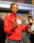图文-土耳其奥运健儿回国 两枚奖牌交相辉映