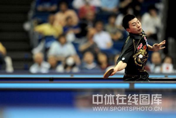 图文-世乒赛男单八分之一决赛马龙奋力面部变形