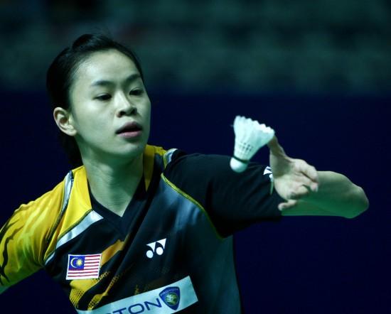 图文-中国羽毛球公开赛黄妙珠晋级发球瞬间