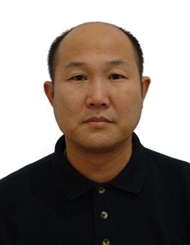 图文-北京奥运中国代表团网球队队员 教练员王金禄