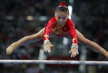He Kexin dominating the parallel bars at Beijing Olympics.